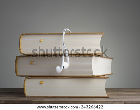 Book with headphones on the table. concept of education - stock photo