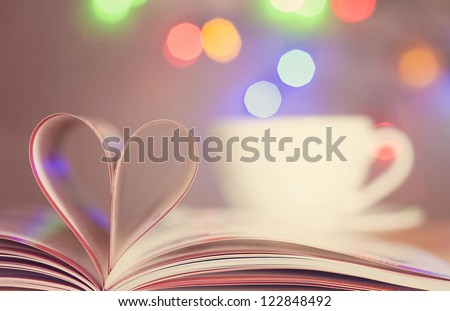 Book with pages folded into a heart shape - stock photo
