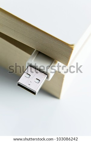 Book with USB plug . Macro shot , focus on a center.