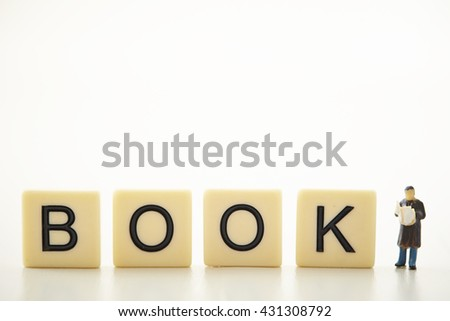 BOOK word blocks with miniature man