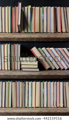 Bookcase, books on the shelves close up. Library. Back to school.