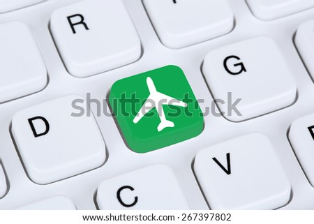 Booking flight and holidays online shopping e-commerce internet travel shop on computer - stock photo