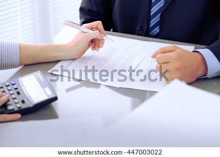 Bookkeepers or financial inspector making report, calculating or checking balance. Audit concept.  - stock photo