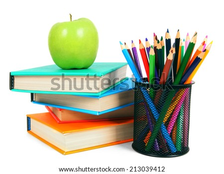 Books, an apple and pencils. On a white background. - stock photo
