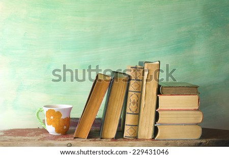 books and a cup of coffee, reading, learning concept, free copy space  - stock photo
