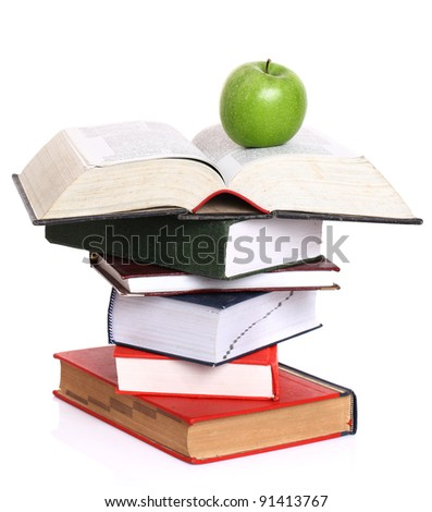 books and apple on a white background - stock photo