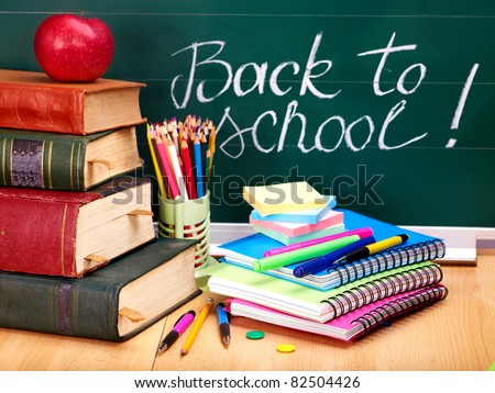 Books and blackboard. School supplies.. Back to school. - stock photo