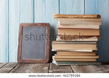 Books and chalk board for your text. Back to school concept with copy space