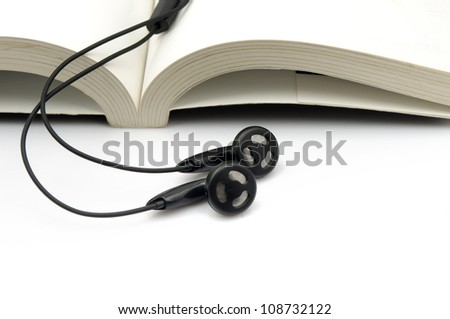 Books and ear plugs - stock photo