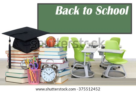 books and empty classroom for back to school concept - stock photo