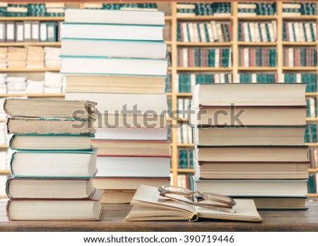 Books and eyeglasses  - stock photo