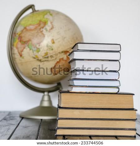 books and globe - stock photo