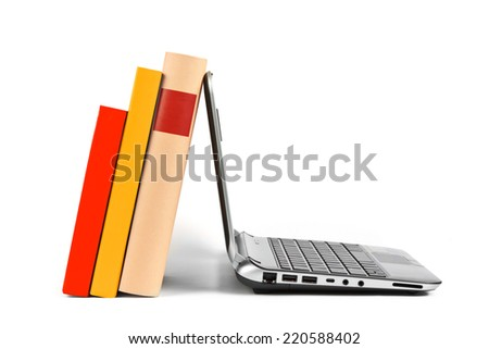 Books and laptop  - stock photo