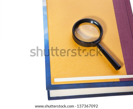 books and magnifying glass isolated on white background - stock photo