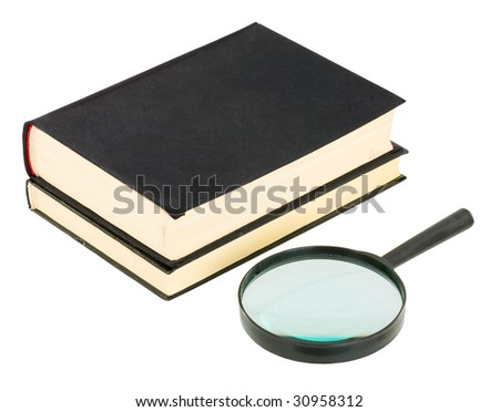 Books and magnifying glass on the white background - stock photo