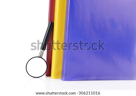 books and magnifying glass. room for text. Symbol of knowledge and science - stock photo