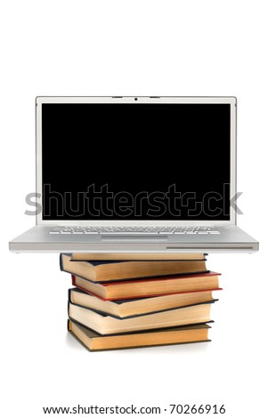 books and new laptop on a white background - stock photo