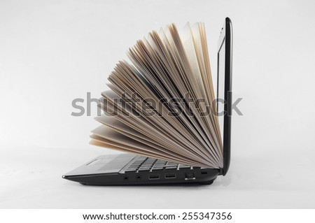 Books and pc bring culture and knowledge to humanity - stock photo
