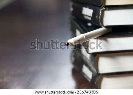 books and pen, education, study background - stock photo
