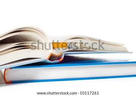 Books and pencil on a white background