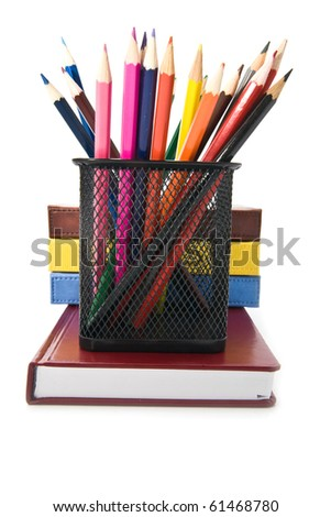 books and pencils on a white background