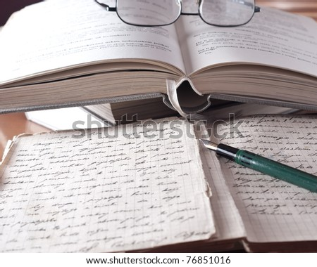 books and volumes on the table - stock photo