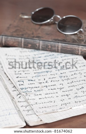 books and volumes on the table close up photo - stock photo