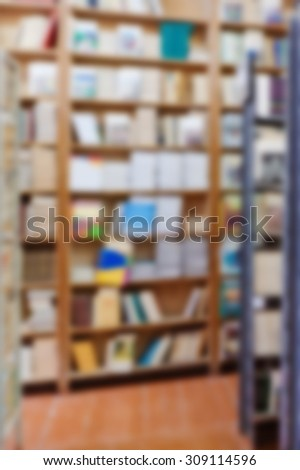 books are on the shelves in the library - stock photo