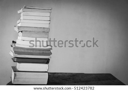 books array together on table with shadow in white tone