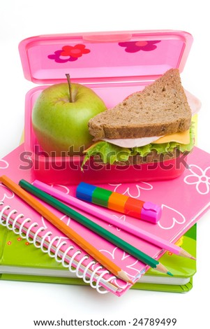 books, color pens and lunch box with sandwich - stock photo