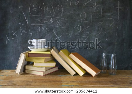 books, cup of coffee, black board, education, learning ,science concept - stock photo