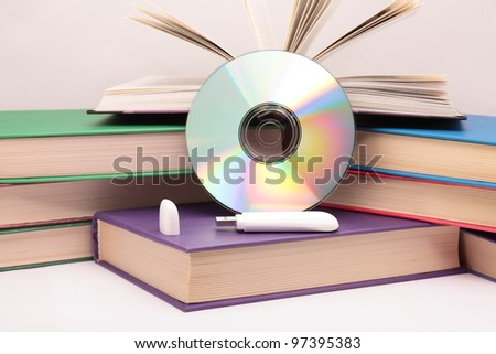 Books, flash drive and CD. - stock photo