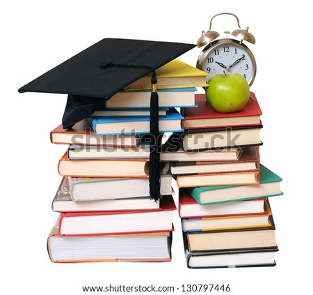 books, graduated cap, clock and apple isolated on white - stock photo