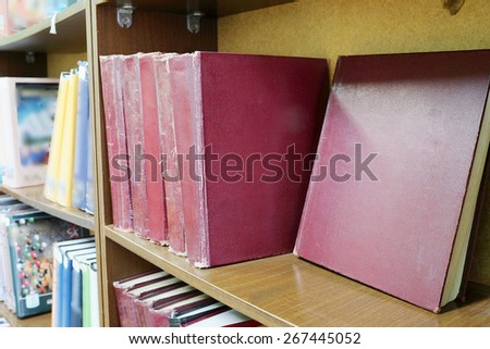 Books in a row. Bookshelf in public library. - stock photo