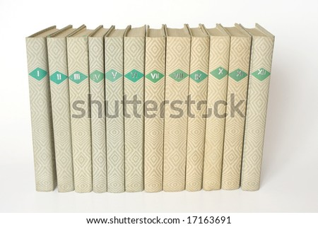 books in a row. isolated on white background. clipping path included. - stock photo