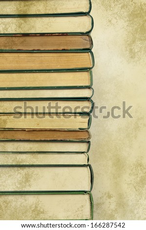 books in a row on old paper  - stock photo