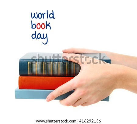 Books in hands and World Book Day text isolated on white - stock photo