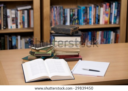 Books, notepad and pen - stock photo