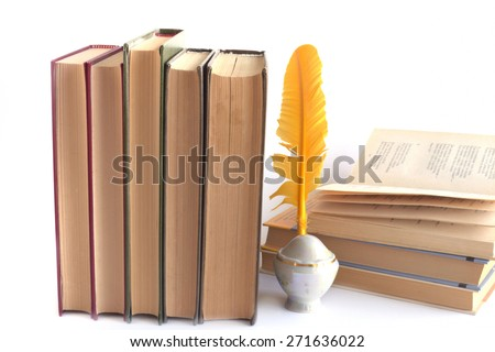 books of poems and quill Pen and ink bottle isolated on white background - stock photo