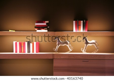books on a shelf in the living room - stock photo