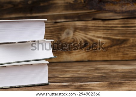 Books on a wooden background - stock photo