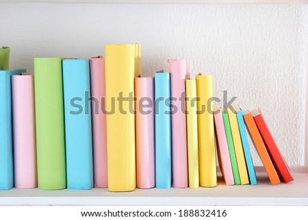 Books on shelf close-up - stock photo
