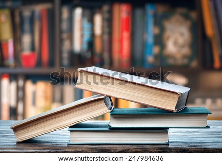 Books on the shelf - stock photo