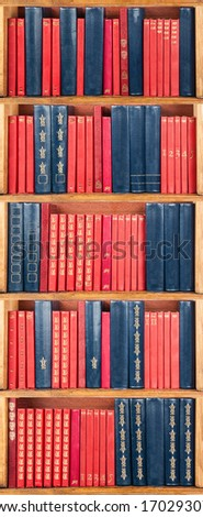 books on the shelf - red and blue - stock photo
