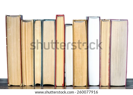 Books on the shelf with isolated background - stock photo