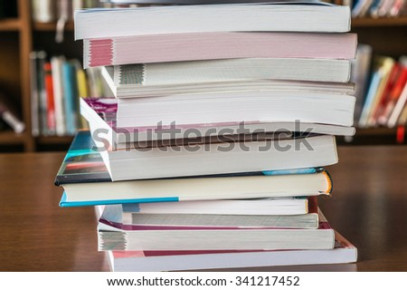 Books on the table in the library - stock photo