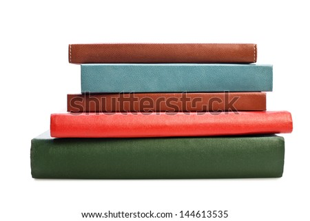 Books on white background. No labels, blank spine.