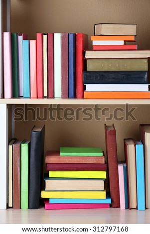 Books on wooden shelf.