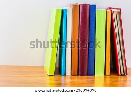 Books on wooden shelf close-up - stock photo