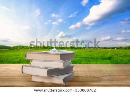 Books outdoors - stock photo